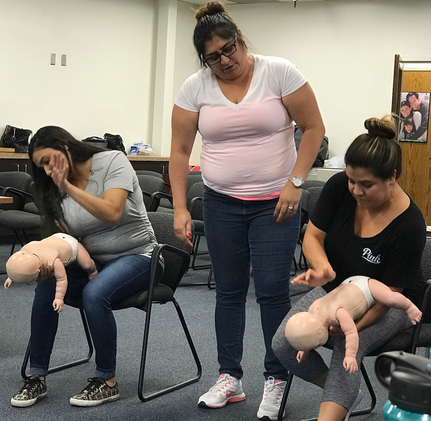 CPR Instructor showing CPR for babies