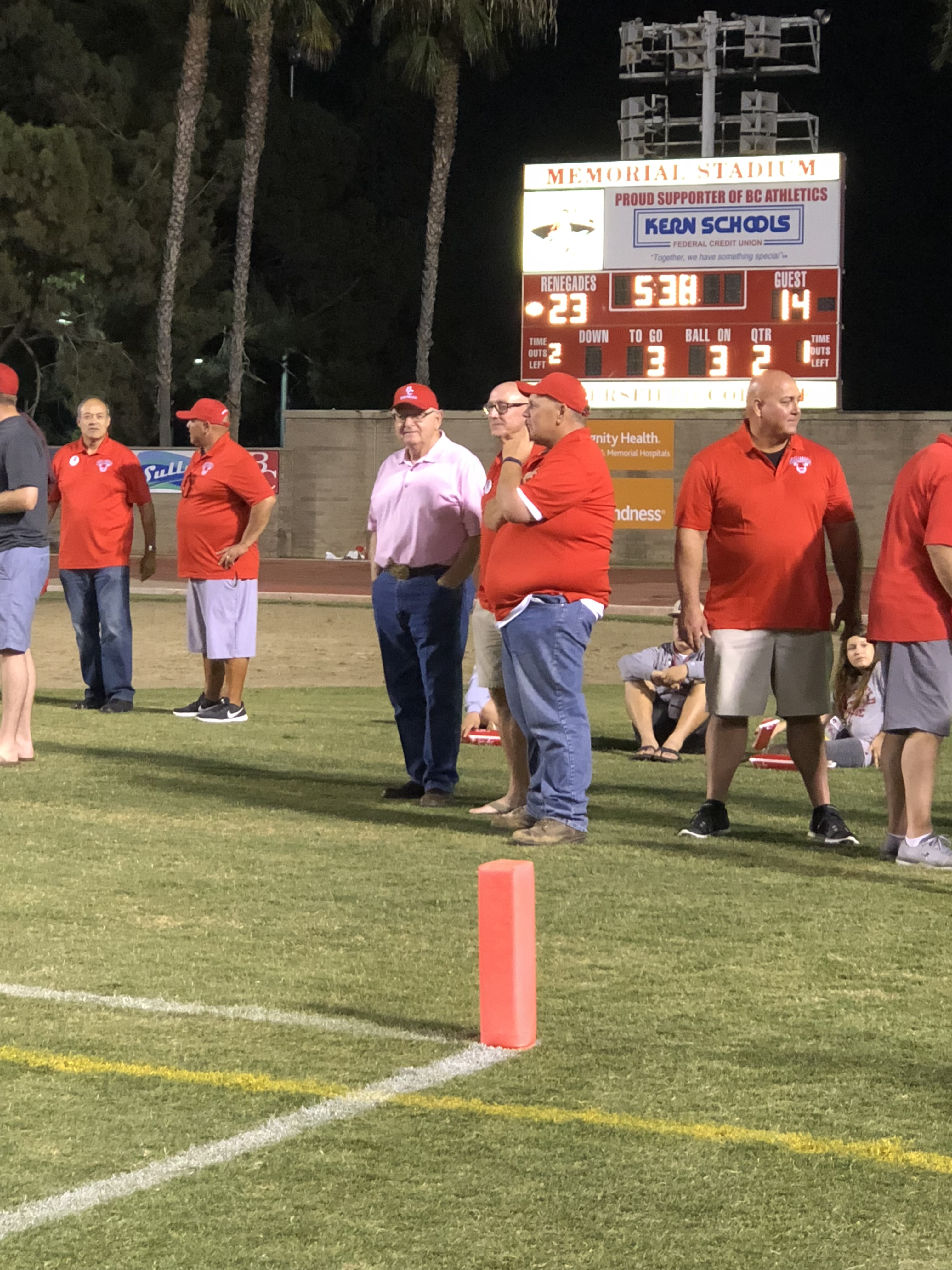Frank on the sidelines with staff and coaches